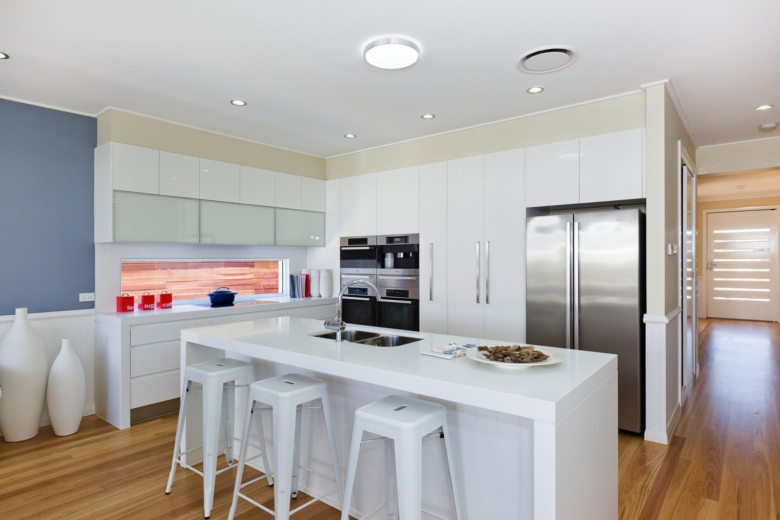 Blackbutt timber flooring supplied and installed into modern white kitchen by Timber Floors Pty Ltd