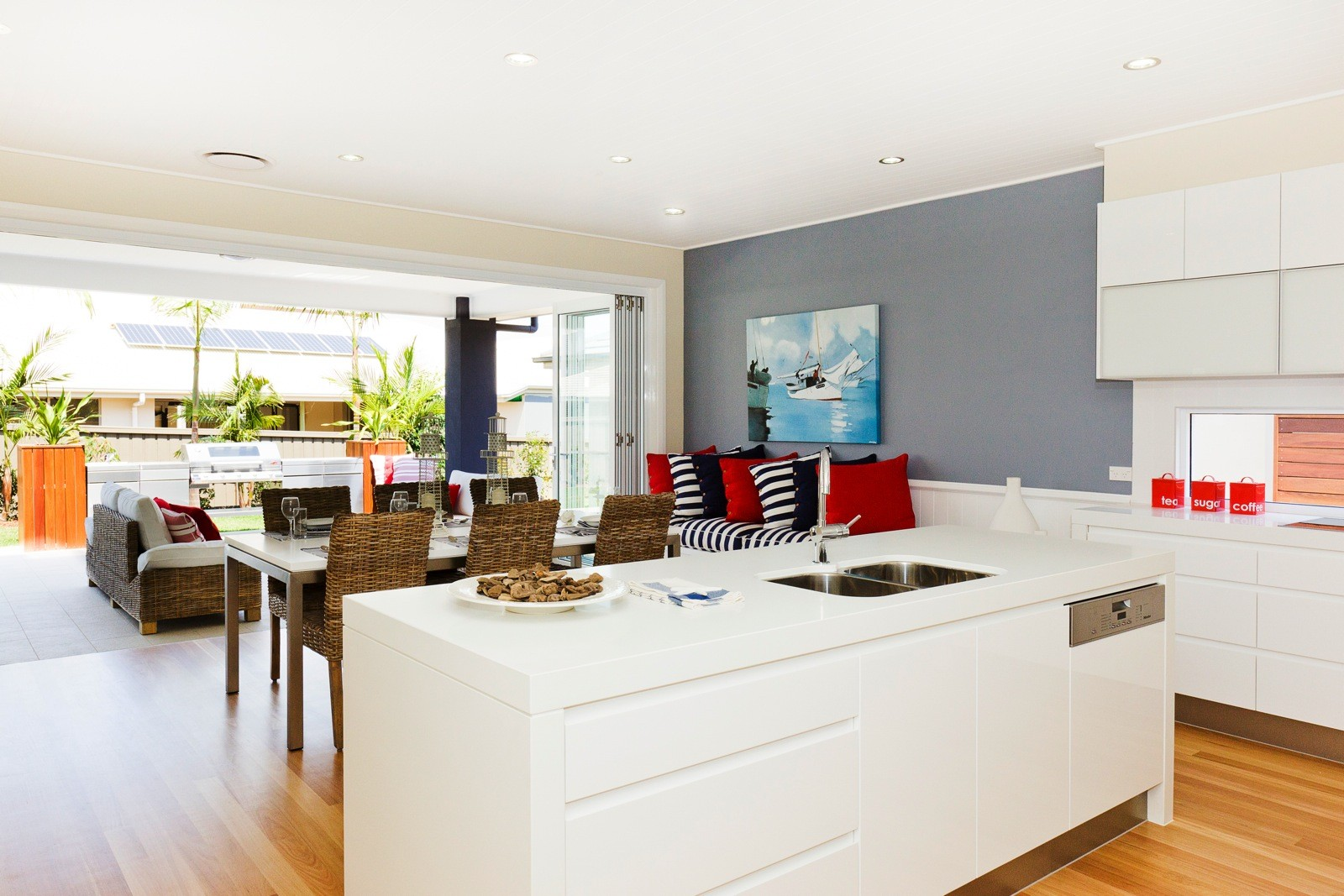 Blackbutt timber flooring complimenting the White Kitchen and Grey Walls supplied and installed by Timber Floors Pty Ltd