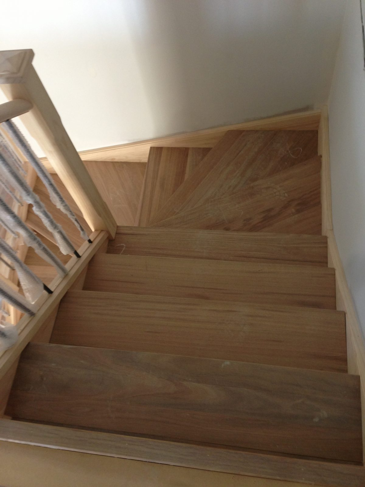 Harrington Park renovation of staircase in spotted gum solid treads and risers and timber floorboards by Timber Floors Pty Ltd