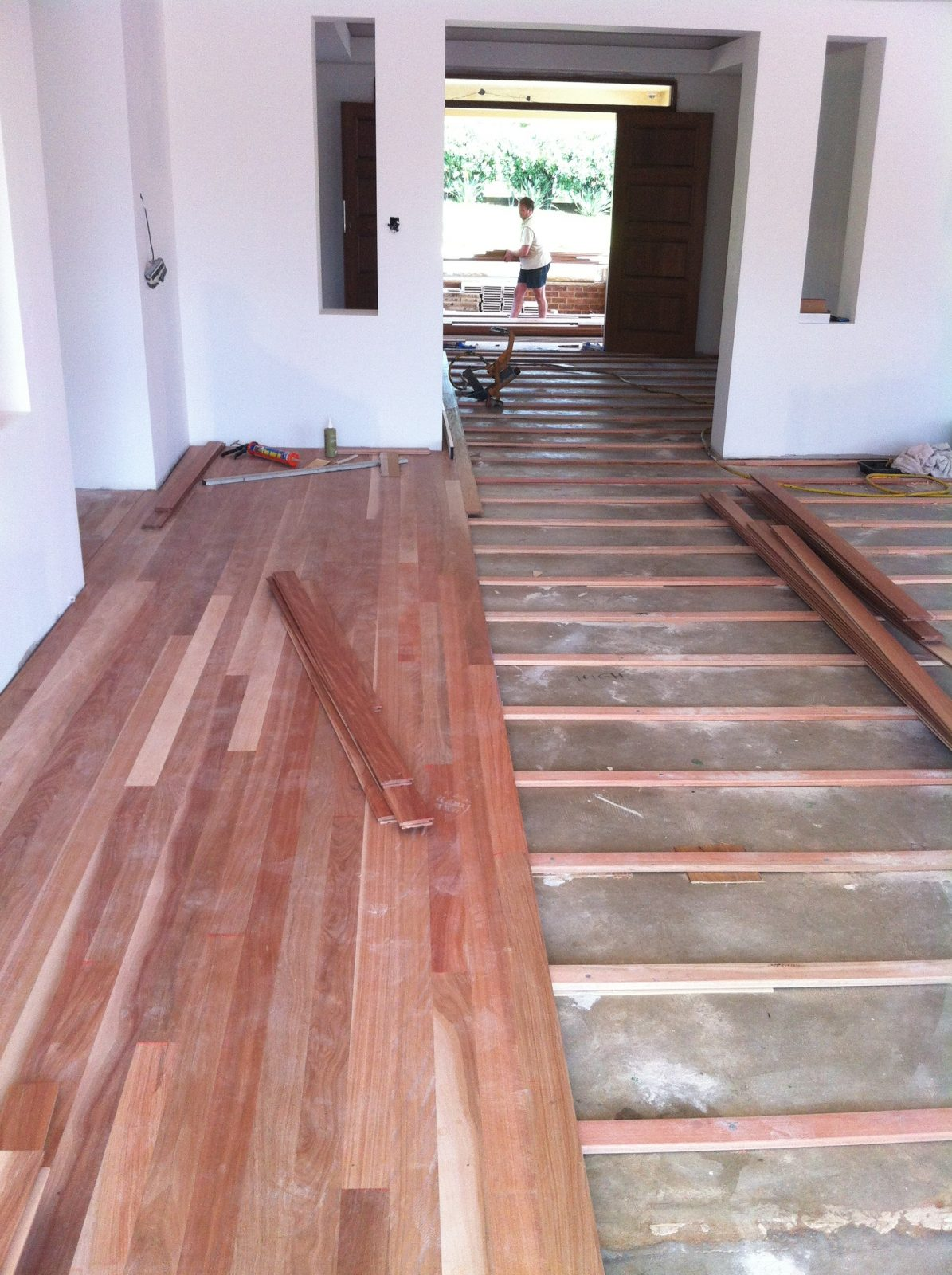 timber flooring being laid over a concrete slab by Australian Hardwood timber flooring specialists Timber Floors Pty Ltd
