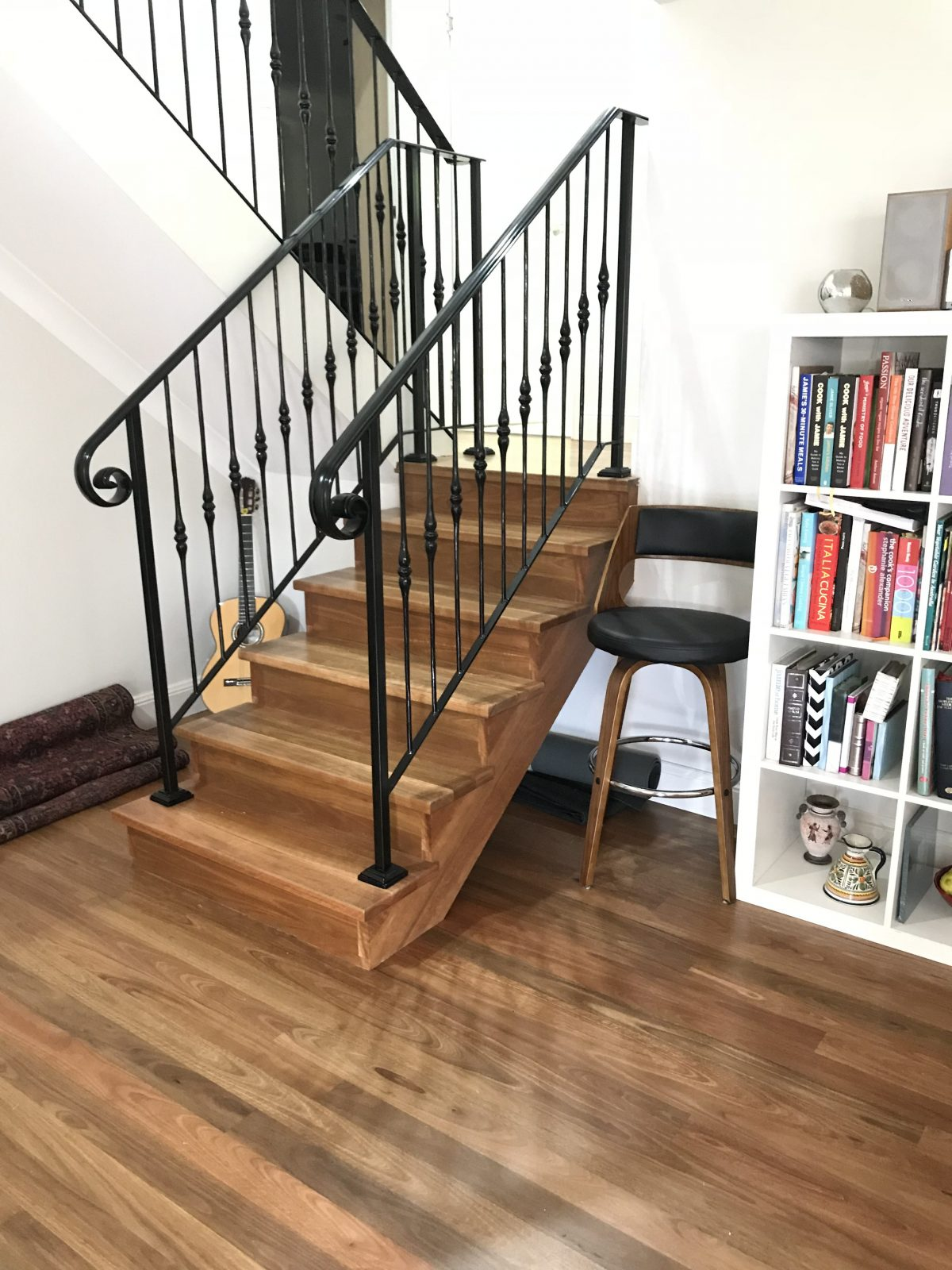 New Spotted Gum timber floor over concrete slab together with sawcut stringer and solid treads and risers stairs supplied and installed by Timber Floors Pty Ltd