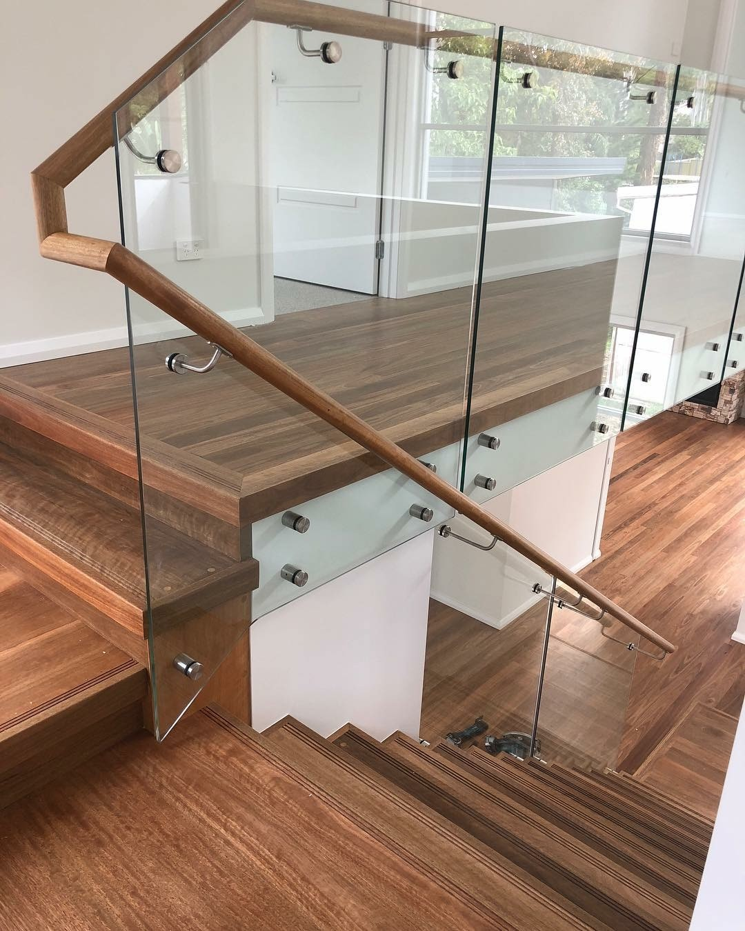 New Spotted Gum timber floor, new treads and risers, glass balustrade and handrails supplied and installed by Timber Floors Pty Ltd over concrete slab