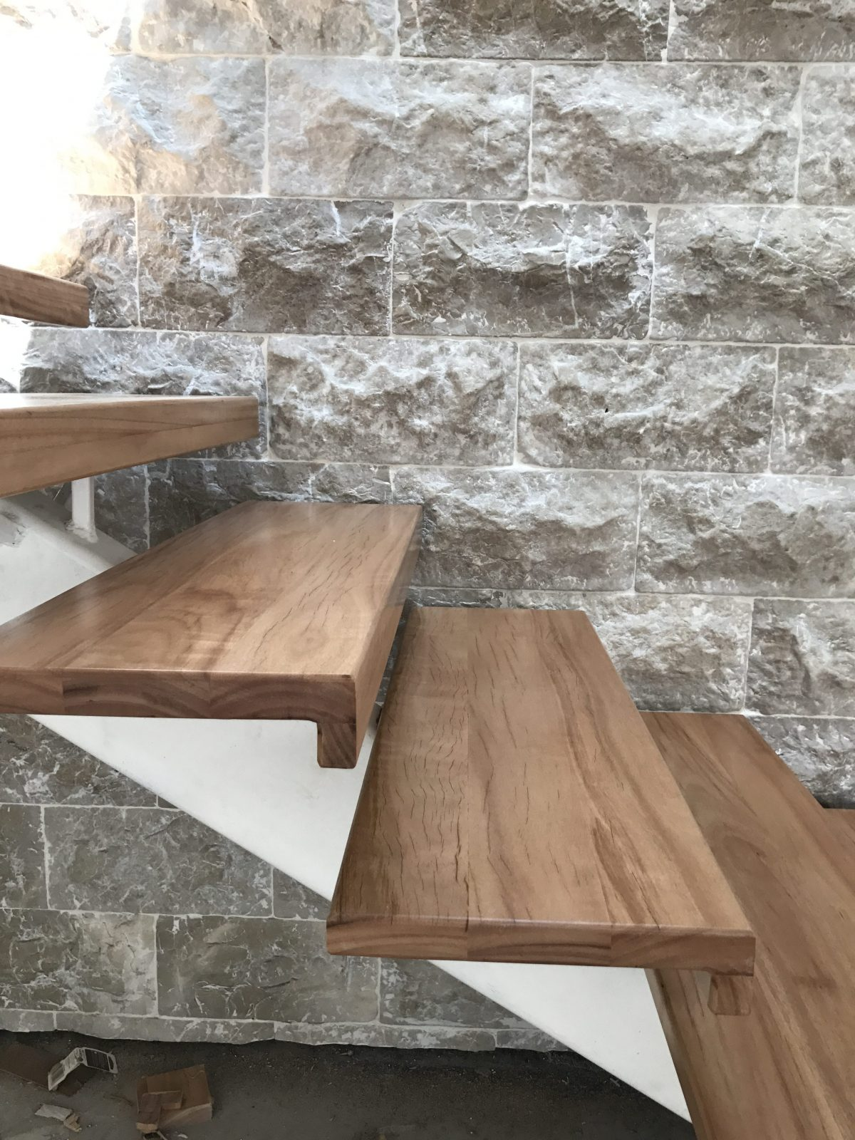 side view of solid treads fitted to steel spine supplied and installed by Timber Floors Pty Ltd