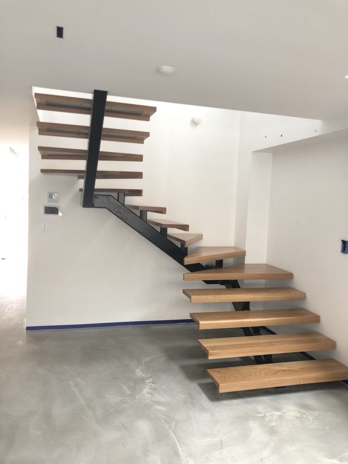 distant view of Solid treads supplied and installed to steel spine by Timber Floors Pty Ltd