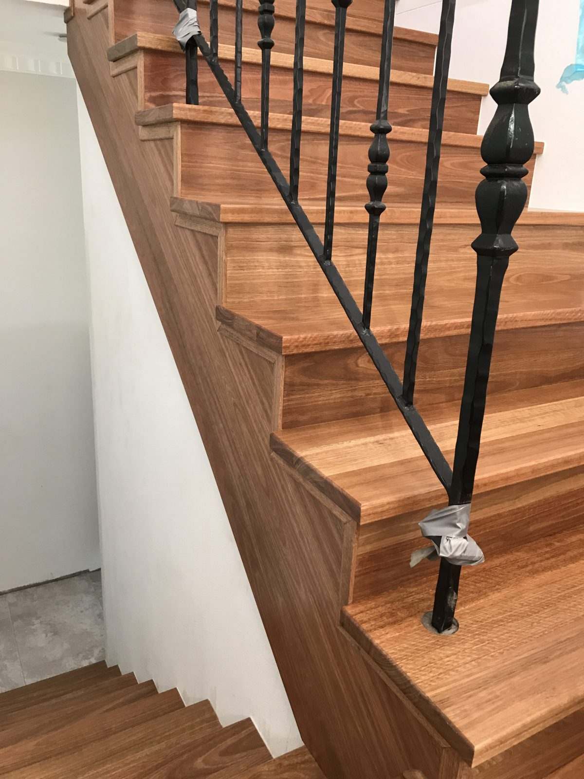 Work in progress - bespoke handrail fitted to solid treads installed over sawcut stringer | modern makeover of old staircase by Timber Floors Pty Ltd