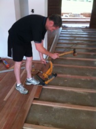 timber flooring being laid over a concrete slab by Rex Bruker - Australian Hardwood timber flooring specialists Timber Floors Pty Ltd