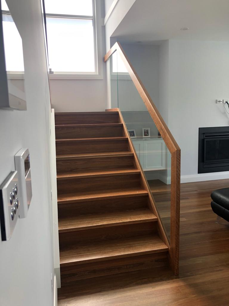 Spotted Gum Solid stair treads and risers - Staircase Makeover by Timber Floors Pty Ltd