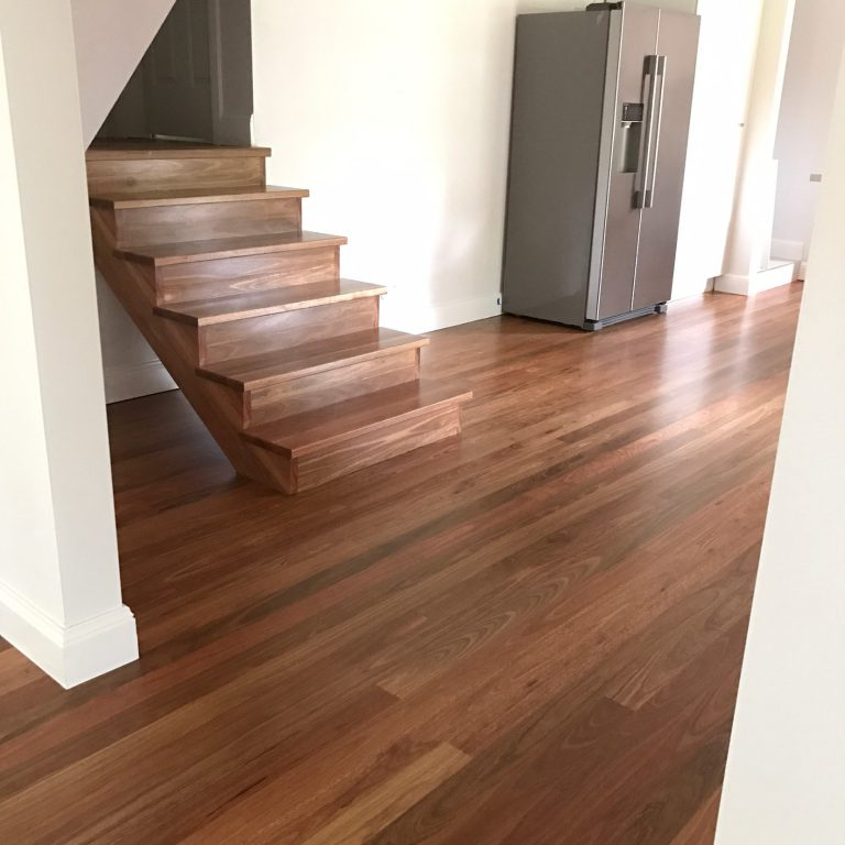 Spotted Gum timber flooring and stair treads supplied and installed by Timber Floors Pty Ltd