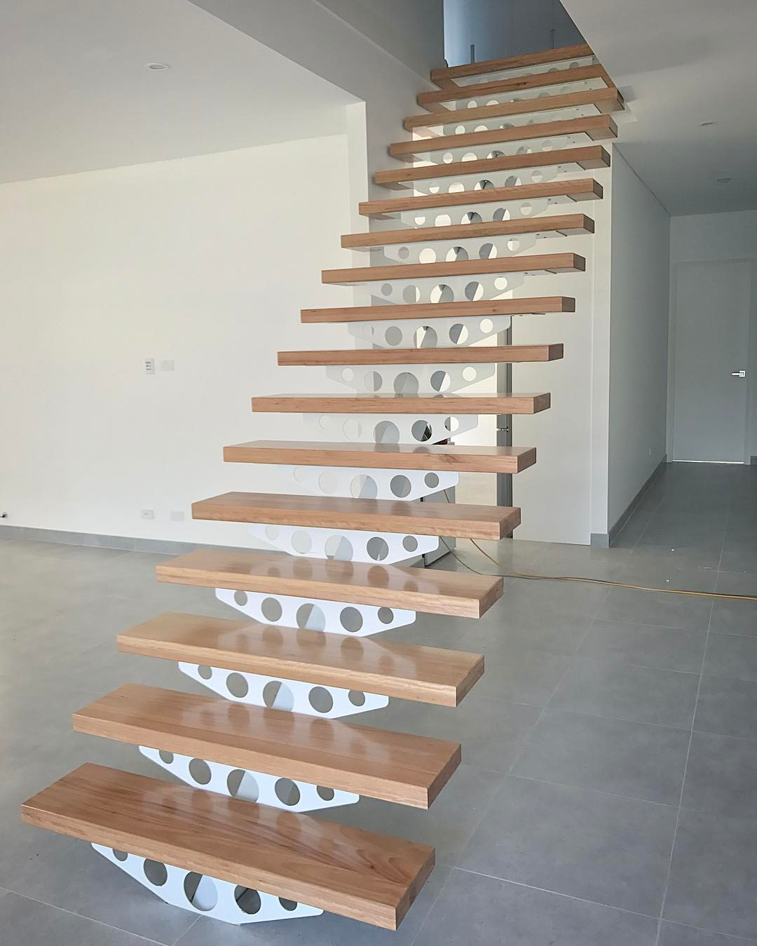 Timber Floors Pty Ltd solid Blackbutt hardwood step treads 65mm thick installed on steel plate monostring staircase by Timber Floors Pty Ltd