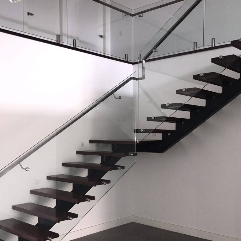 steel-spine-monostring-staircase-with-solid-treads-glass-balustrade-and-modern-handrail-by-Timber-Floors-Pty-Ltd-timber-floors-Sydney