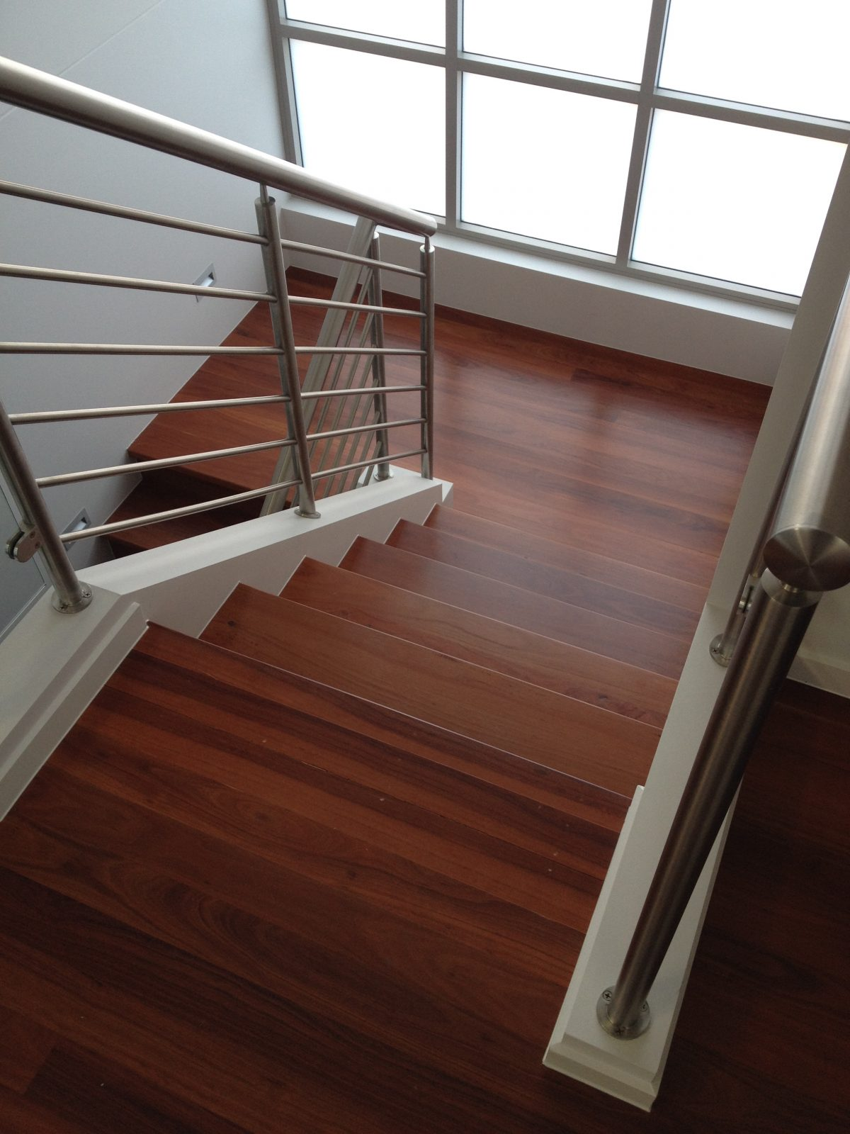 San Souci Red Iron Bark Stair treads with timber flooring landing - polished stainless steel Baluster by Timber Floors Pty Ltd